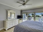 Master Bedroom with TV and Private Access to Balcony at 411 Captains Walk