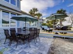 47 Lands End Features Propane Grill and Large Outdoor Dining Table Overlooking the Water