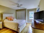Upstairs Guest Bedroom with Queen Bed at 305 Golfmaster