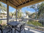 Deck with Dining Table Overlooking Lagoon is a Great Place for Morning Coffee at 609 Barrington Park
