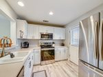 Kitchen with New Stainless Steel Appliances at 507 Queen`s Grant