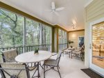 Screened Porch with Dining Table at 8133 Wendover Dunes
