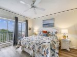 Master Bedroom with King Bed and Balcony Access at 4501 Windsor Court North