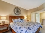 Master Bedroom with King Bed and Private Balcony Access at 101 Barrington Arms