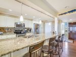 Kitchen features a large breakfast bar with seating for 4 at 1415 South Beach Villa