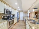 This galley style kitchen is fully equipped with everything you need  - 1415 South Beach Villa