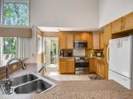 Spacious Kitchen with Breakfast Bar at 14 Green Heron