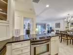 Kitchen Opens to Dining Area and Living Room at 1715 Bluff Villa