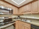 Fully equipped Kitchen at 1723 Bluff Villa in a washer and dryer