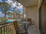 Private Balcony off Master Bedroom Overlooks Calibogue Sound and Pool at 1852 Beachside Tennis
