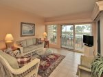 Living Room with tranquil views of Calibogue Sound at 1866 Beachside Tennis