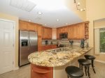 Updated Kitchen with Granite Counters and Stainless Appliances at 1877 Beachside Tennis