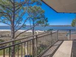 Dine Outside While Enjoying Ocean Views from Balcony at 1879 Beachside Tennis