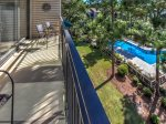 Balcony with Views of the Pool at 1882 Beachside Tennis