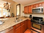 Upgraded Kitchen with Granite and Stainless Steel at 1882 Beachside Tennis