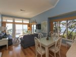 Dining Area with Breaktaking Water Views at 1883 Beachside Tennis