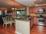 Updated Kitchen with Breakfast Bar seating for 2 at 1887 Beachside Tennis