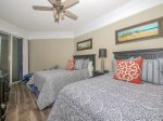 Guest Bedroom with Two Double Beds and Private Balcony at 2112 Sea Crest