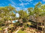 Enjoy views of the oceanfront pool and ocean from the balcony of 2313 Windsor II in Palmetto Dunes
