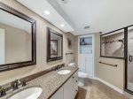 The Master bathroom of 2313 Windsor II was recently renovated and now inlcudes a spacious tiled shower with two shower heads and a seat.