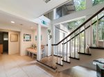 Stairs to Downstairs Den at 26 West Beach Lagoon with Queen Sleeper Sofa