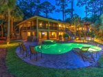 Enjoy you evening swimming in the large pool or out back on the spacious screened porch at 28 Surf Scoter