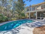Spacious pool deck with plenty of seating at 30 Canvasback