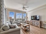 Living Room with TV Offers Pool and Ocean Views at 3102 SeaCrest