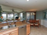 Kitchen Opens to Dining Area and Living Room and has Ocean Views at 3104 Sea Crest