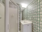 The Full bathroom off the Living Area at 4210 Windsor Court North has a shower only