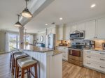 Renovated Kitchen with Breakfast Bar at 46 Lands End