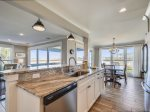Renovated Kitchen Leads into Dining Area at 46 Lands End