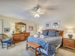 Master Bedroom with TV and Access to Screened Porch at 4 Audubon Pond