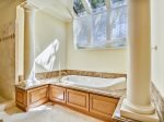 Spacious Master Bathroom with Double Vanity, Walk In Shower and Soaking Tub