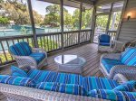 Spacious Screened Porch Overlooks Tennis Court at 6 Beachside