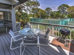 Outside Deck with Grill and Dining Table at 6 Beachside