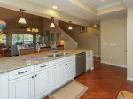 Kitchen Opens to Dining Area and Living Room at 6 Beachside