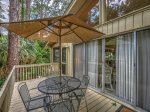Covered Patio with Dining Table that Overlooks the Pool at 7 Laughing Gull