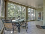 Screened Porch with Dining Table for Six at 8123 Wendover Dunes