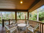 Enjoy Dining Outside on the Large Covered Deck Overlooking Pool and Lagoon at 8 Cottage Court
