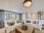 Renovated Downstairs Den with New Furniture and Pool Deck Access at 8 East Beach Lagoon