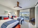 Downstairs Twin Bedroom with Ocean Access at 8 East Beach Lagoon