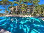 The spacious pool deck offers plenty of room for guests and wonderful views of the water