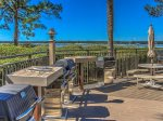 The grilling and picnic area is located beside the pool at Beachside Tennis