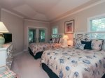 Geust Bedroom has two Queen beds and access to the screened in porch at 8116 Wendover Dunes