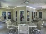 Large Screened In Porch at 8116 Wendover Dunes has a table for dining al fresco