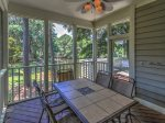 Screened in Porch at 7640 Huntington has another table that seats 6 and overlooks the lagoon in Palmetto Dunes