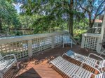 Just off the screened proch in 7640 Huntington is a deck with lounging charis and a BBQ