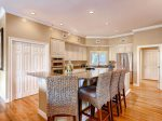 Gourmet kitchen includes a breakfast bar with seating for 4 in 3 Pyxie