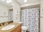 Guest Bathroom with Shower/Tub Combo at 473 Captains Walk